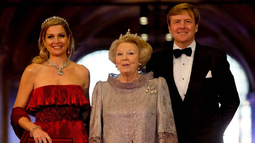 Dutch Queen Beatrix, center, and Dutch Crown Prince Willem-Alexander and his wife Princess Maxima arrive for a banquet hosted by the Dutch Royal family at the Rijksmuseum, Amsterdam,  The Netherlands, Monday, April 29, 2013. Queen Beatrix has announced she will relinquish the crown on April 30, 2013, after 33 years of reign, leaving the monarchy to her son Crown Prince Willem-Alexander.  (AP Photo/Robin Utrecht, pool)