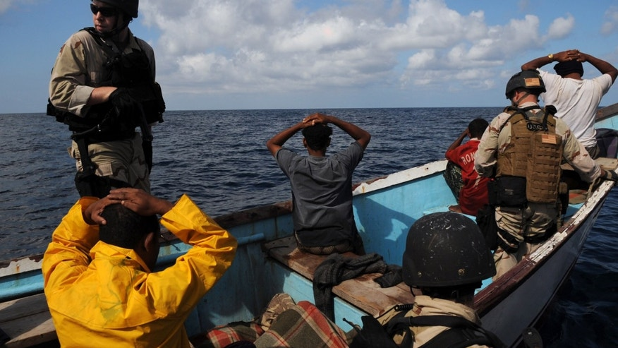 GULF OF ADEN - OCTOBER 15:  In this photo provided by the U.S. Navy, Members of a visit, board, search and seizure team from the guided-missile cruiser USS Anzio (CG 68) and U.S. Coast Guard Maritime Safety and Security Team 91104 secure the crewmembers of a drug smuggling vessel October 15, 2009 in the Gulf of Aden. Anzio is the flagship of Combined Joint Task Force 151, a multinational task force established to conduct counter-piracy operations off the coast of Somalia. (Photo by Matthew Bash/U.S. Navy via Getty Images)