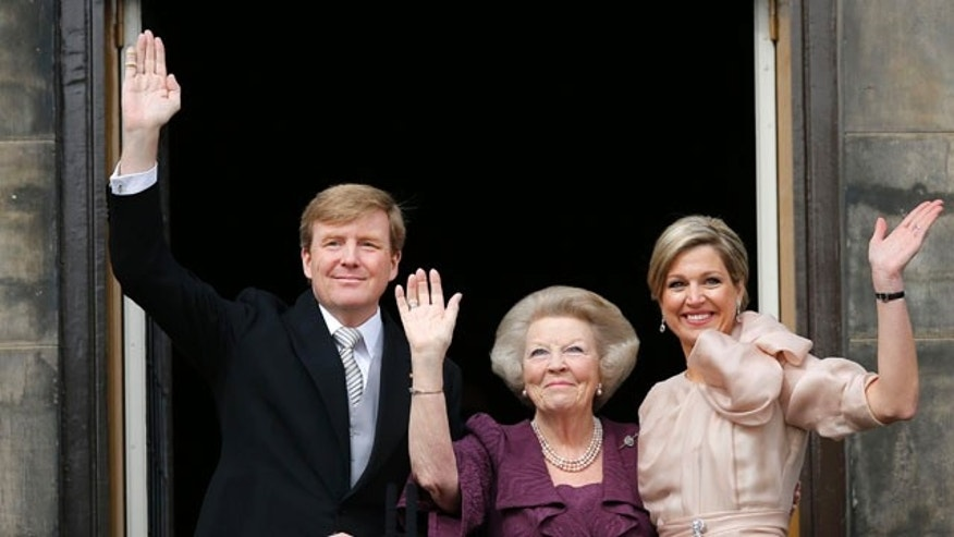 April 30, 2013: Dutch King Willem-Alexander, Queen Maxima, right, and Princess Beatrix appear on the balcony of the Royal Palace in Amsterdam, The Netherlands.