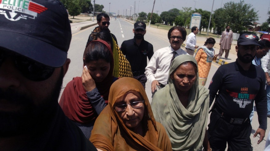 Family members of jailed Indian spy Sarabjit Singh, leave en route to India at Wagah border near Lahore, Pakistan, Wednesday, May 1, 2013. Singh who is on death row was critically injured when he was attacked with a brick inside a prison in the eastern city of Lahore. Singh was arrested in 1990 for his role in series of bombings in Lahore and Faisalabad that killed 14 people. (AP Photo/K.M. Chaudary)