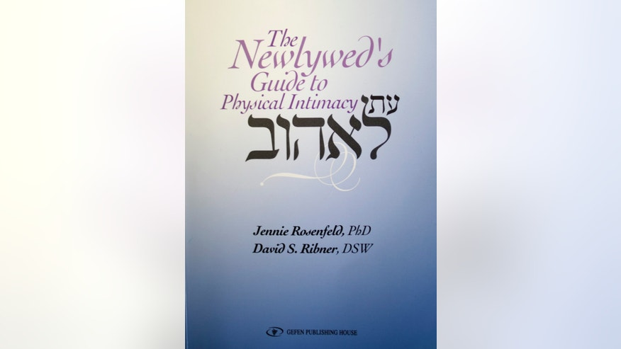 "A reproduction picture of the book titled ""The newlywed's guide to physical intimacy,"" Wednesday, May 1, 2013. A new book spelling out the how-to's of sexual intercourse aims to get Israel's Orthodox Jews talking about sex, targeting an audience typically mum on the steamy subject. (AP Photo)"