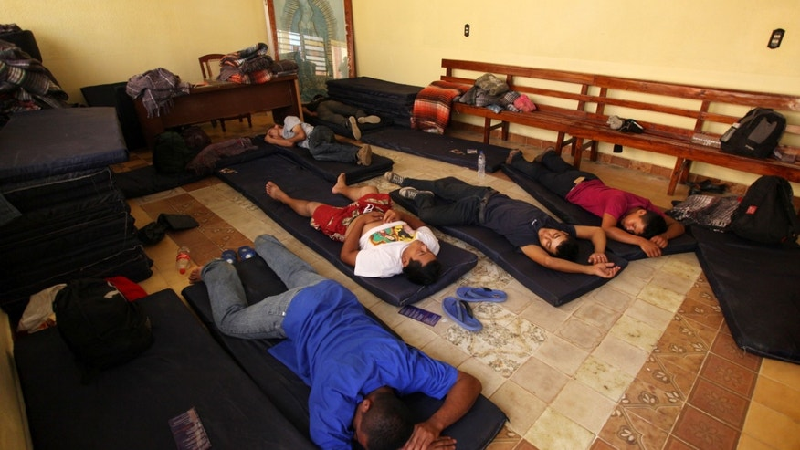 A group of Central American migrants rest at a shelter after they were attacked on the freight train they were riding through Mexico, in Acayucan, Mexico, Thursday, May 2, 2013. The United States-bound migrants had hopped on the train in southern Mexico and were traveling through the Gulf Coast state of Veracruz when attackers shot and cut them with machetes. Some jumped from the train to escape and others were thrown off, said migrants' rights activist Tomas Gonzalez Castillo. At least 10 Honduran migrants are recovering from wounds suffered in the attack. (AP Photo/Felix Marquez)