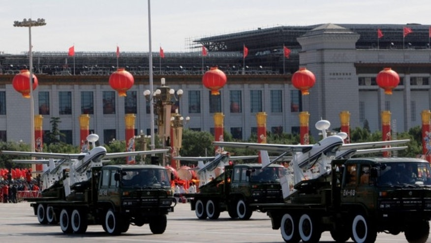 Oct. 1, 2009: Trucks loaded with the Chinese made drones, the ASN-207, take part in a military parade marking China's 60th anniversary held near Tiananmen Square in Beijing.