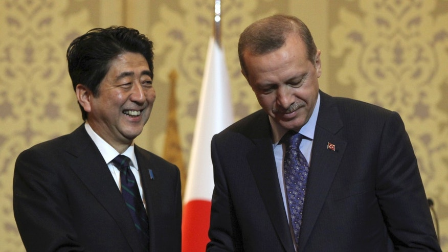 Japanese Prime Minister Shinzo Abe, left, and his Turkish counterpart Recep Tayyip Erdogan shake hands after they signed agreements in Ankara, Turkey, Friday, May 3, 2013.(AP Photo/Burhan Ozbilici)