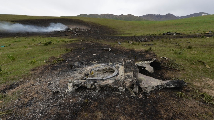 May 3, 2013 - Wreckage from a U.S. Air Force KC-135 tanker aircraft wreckage is strewn across a field near the village of Chaldovar, Kyrgyzstan.