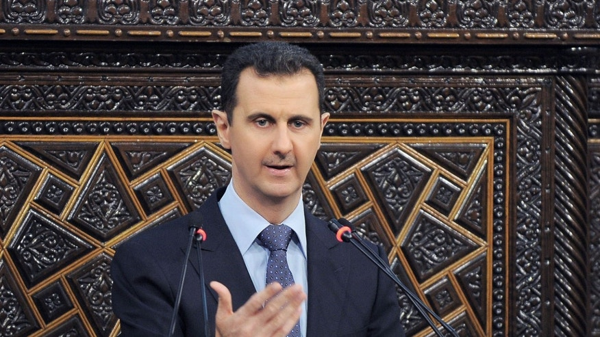 FILE - In this  June 3, 2012 file photo released by the Syrian official news agency SANA, Syrian President Bashar Assad delivers a speech at the parliament in Damascus, Syria. Israel launched an airstrike into Syria, apparently targeting a suspected weapons site, U.S. officials said Friday night, May 3, 2013. (AP Photo/SANA, File)