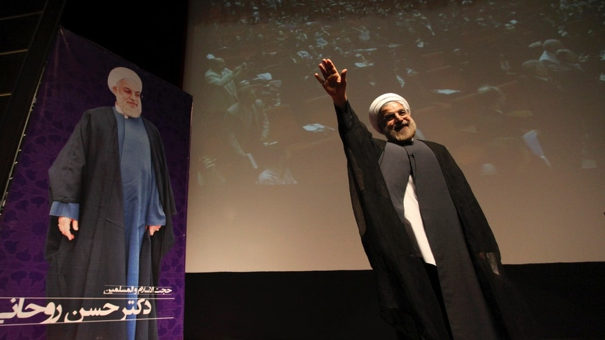 In this Thursday, May 2, 2013 photo, Iran's former nuclear negotiator, Hasan Rohani, a potential front-runner in the presidential race, waves to his supporters in a campaign rally in Tehran, Iran. For eight years, Iran's President Mahmoud Ahmadinejad has played the role of global provocateur-in-chief: questioning the Holocaust, saying Israel should be erased from the map and painting U.N resolutions as worthless. Now, a race is beginning to choose his successor -- candidate registration starts Tuesday for a June 14 vote -- and it looks like an anti-Ahmadinejad referendum is shaping up. (AP Photo/Vahid Salemi)