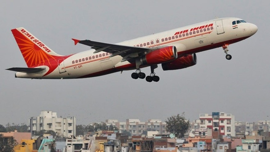 Jan. 30, 2013: An Air India passenger plane takes off from Sardar Vallabhbhai Patel International Airport in the western Indian city of Ahmedabad, India.