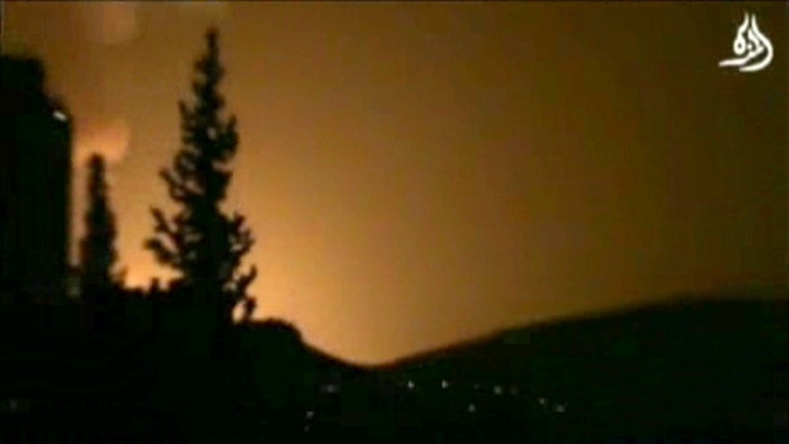 In this image taken from video obtained from Shaam News Network, which has been authenticated based on its contents and other AP reporting, smoke and fire fill the skyline over Damascus, Syria, early Sunday, May 5, 2013 after an Israeli airstrike. Israeli warplanes struck areas in and around the Syrian capital Sunday, setting off a series of explosions as they targeted a shipment of highly accurate, Iranian-made guided missiles believed to be on their way to Lebanon's Hezbollah militant group, officials and activists said. The attack, the second in three days, signaled a sharp escalation of Israel's involvement in Syria's bloody civil war. Syria's state media reported that Israeli missiles struck a military and scientific research center near the Syrian capital and caused casualties. (AP Photo/Shaam News Network via AP video)