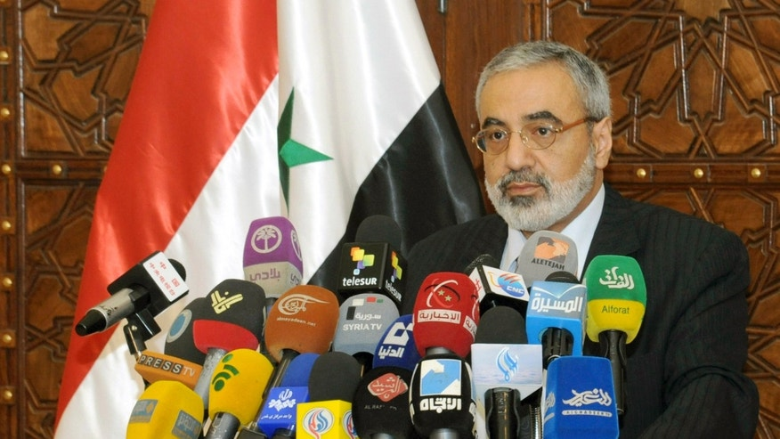 "In this photo released by the Syrian official news agency SANA, Syrian Information Minister Omran al-Zoubi speaks during a press conference in Damascus, Syria, Sunday, May. 5, 2013. Al-Zoubi says the Israeli attack is evidence of the Jewish state's links with Islamic extremist groups trying to overthrow President Bashar Assad's regime. He added that Syria has the right and the duty ""to defend its people by all available means."" (AP Photo/SANA)"