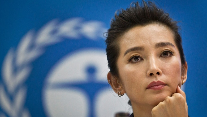 "Chinese actress and United Nations Environment Programme (UNEP) Goodwill Ambassador Li Bingbing speaks about the illegal ivory trade at a press conference held at UNEP headquarters in Nairobi, Kenya Monday, May 6, 2013. Bingbing, who has starred in a number of high-profile English-language films including ""Resident Evil"" and ""The Forbidden Kingdom"", is in Kenya to bring attention to the growing problem of the international ivory trade, and on Tuesday urged governments and consumers to combat the illegal wildlife trade. (AP Photo/Ben Curtis)"