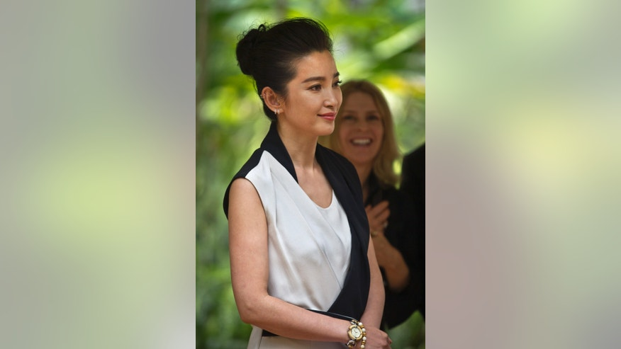 "Chinese actress and United Nations Environment Programme (UNEP) Goodwill Ambassador Li Bingbing arrives to speak about the illegal ivory trade at a press conference held at UNEP headquarters in Nairobi, Kenya Monday, May 6, 2013. Bingbing, who has starred in a number of high-profile English-language films including ""Resident Evil"" and ""The Forbidden Kingdom"", is in Kenya to bring attention to the growing problem of the international ivory trade, and on Tuesday urged governments and consumers to combat the illegal wildlife trade. (AP Photo/Ben Curtis)"