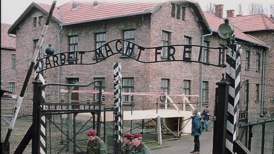 "FILE photo of the gate at Auschwitz, former Nazi concentration camp, with slogan ""Work Makes You Free.""  A 94-year-old man who was deported from the U.S. for lying about his Nazi past was ordered released from custody after a German court said it has ""serious doubts"" that he is fit to stand trial on charges he served as an Auschwitz death camp guard."