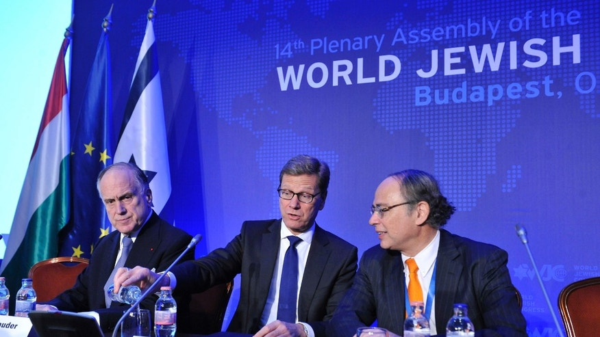 From left to right, President of the World Jewish Congress Ronald S. Lauder, German Foreign Minister Guido Westerwelle and President of the Central Council of Jews in Germany Dieter Graumann attend the 14th Plenary Assembly of the World Jewish Congress in Budapest, Hungary, Monday, May 06, 2013. (AP Photo/MTI, Lajos Soos)