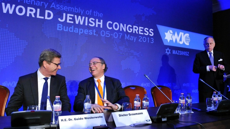 From left to right, German Foreign Minister Guido Westerwelle, President of the Central Council of Jews in Germany Dieter Graumann and President of the World Jewish Congress Ronald S. Lauder attend the 14th Plenary Assembly of the World Jewish Congress in Budapest, Hungary, Monday, May 6, 2013. (AP Photo/MTI, Lajos Soos)