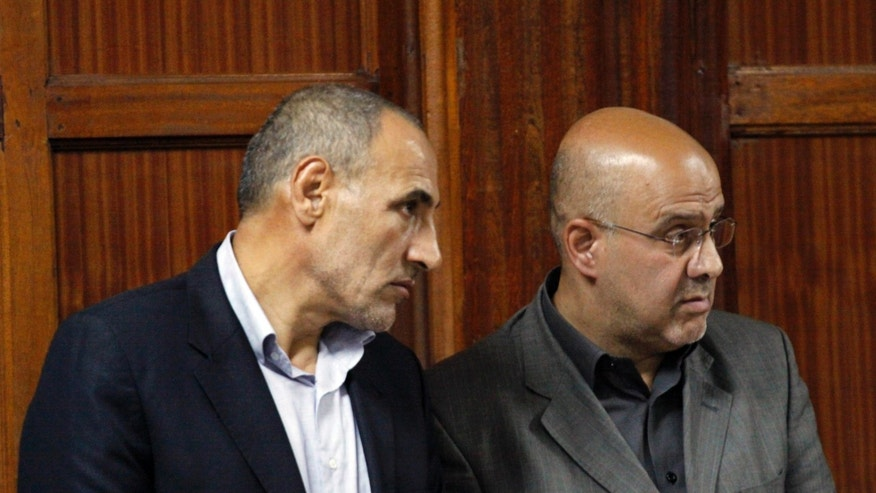 "Two Iranian nationals Ahmed Abolfathi Mohammed, right, and Sayed Mansour Mousavi, left, as they await judgement inside the magistrate court in Nairobi, Kenya, Monday, May 6, 2013.  The two men were convicted of plotting attacks against western and Israeli targets, to life in prison.  The two Iranian nationals Ahmad Abolfathi Mohammad and Sayed Mansour Mousavi were arrested in June 2012, and prosecutors said the two had explosives ""in circumstances that indicated they were armed with the intent to commit grievous harm"", and they are suspected of involvement in attacks, or thwarted attacks, around the globe, including in Azerbaijan, Thailand and India. (AP Photo/Khalil Senosi)"