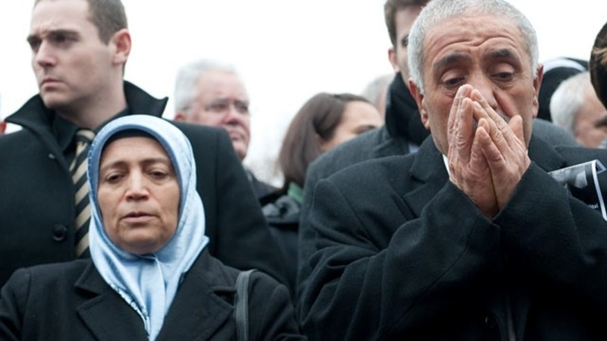 April 6, 2013: Ismail Yozgat , right, and Ayse Yozgat , left, pray at a memorial event on the seventh anniversary of the murder of their son Halit, who was killed by the NSU terror group, in Kassel, Germany.
