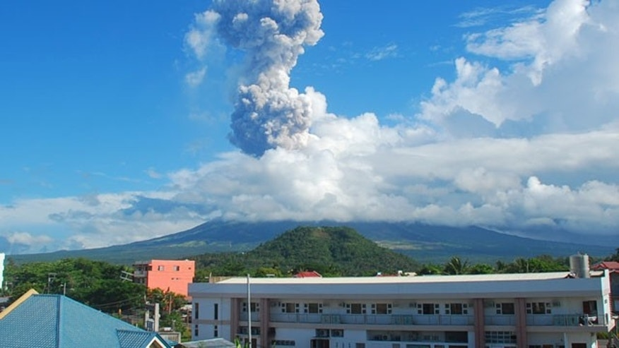 May 7, 2013: A mushroom of volcanic ash shoots up to the sky as Mayon volcano, one of the Philippines' most active volcanoes, spewed huge rocks and ash after daybreak.