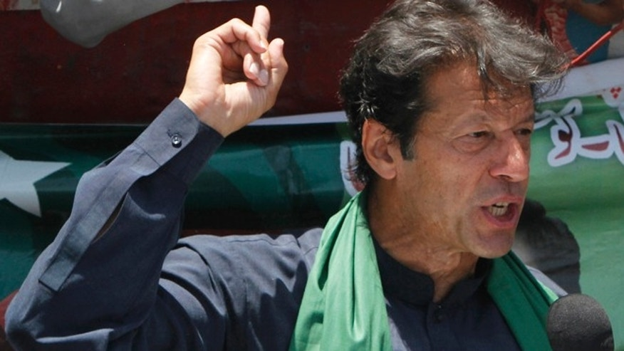 May 7, 2013: Pakistan's cricket star-turned-politician Imran Khan speaks to his supporters during an election campaign in Karachi, Pakistan.