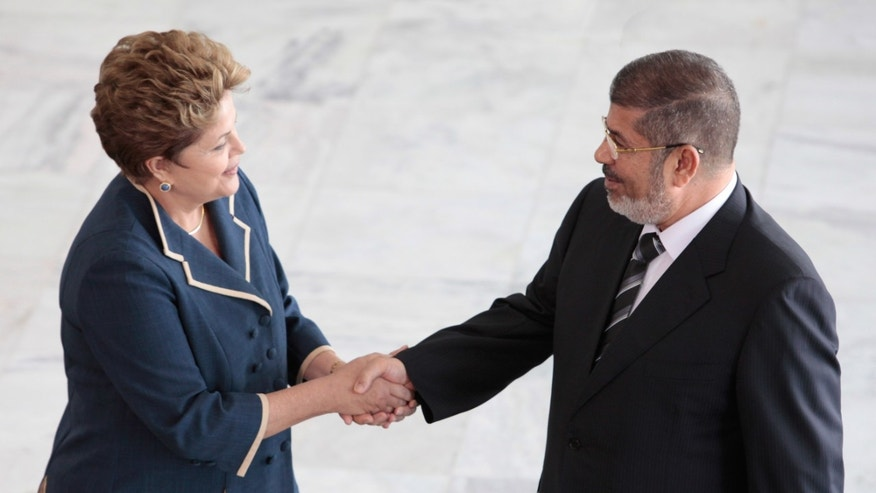 Brazil's President Dilma Rousseff receives Egyptian President Mohammed Morsi at the Planalto presidential palace in Brasilia, Brazil, Wednesday, May 8, 2013. Morsi is on two-day visit to Brazil. (AP Photo/Eraldo Peres)