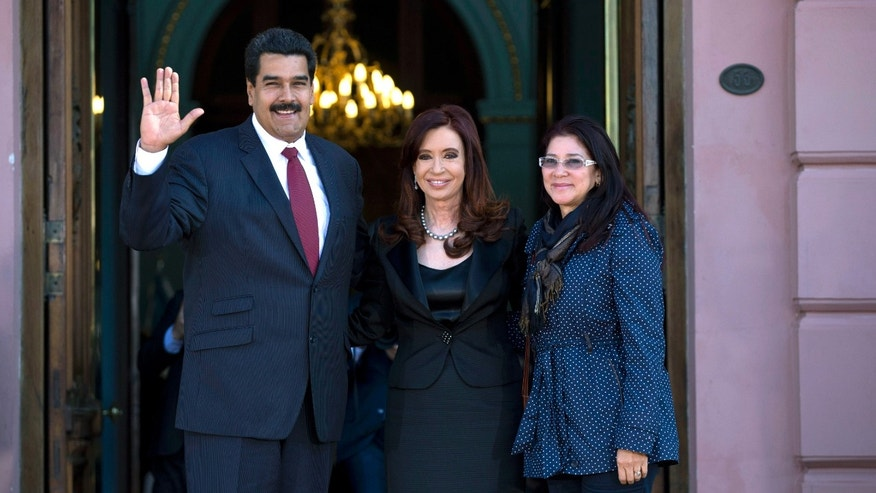 Venezuela's President Nicolas Maduro, left, and his long time partner Cilia Flores, right, pose for a picture with Argentina's President Cristina Fernandez at the government house in Buenos Aires, Argentina, Wednesday, May 8, 2013. Maduro is on a South American tour that began in Uruguay and will end in Brazil. (AP Photo/Natacha Pisarenko)