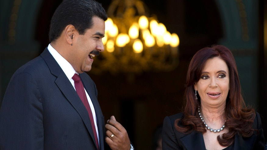 Venezuela's President Nicolas Maduro, left, talks with Argentina's President Cristina Fernandez at the government house in Buenos Aires, Argentina, Wednesday, May 8, 2013.  Maduro is on a South American tour that began in Uruguay and will end in Brazil. (AP Photo/Natacha Pisarenko)