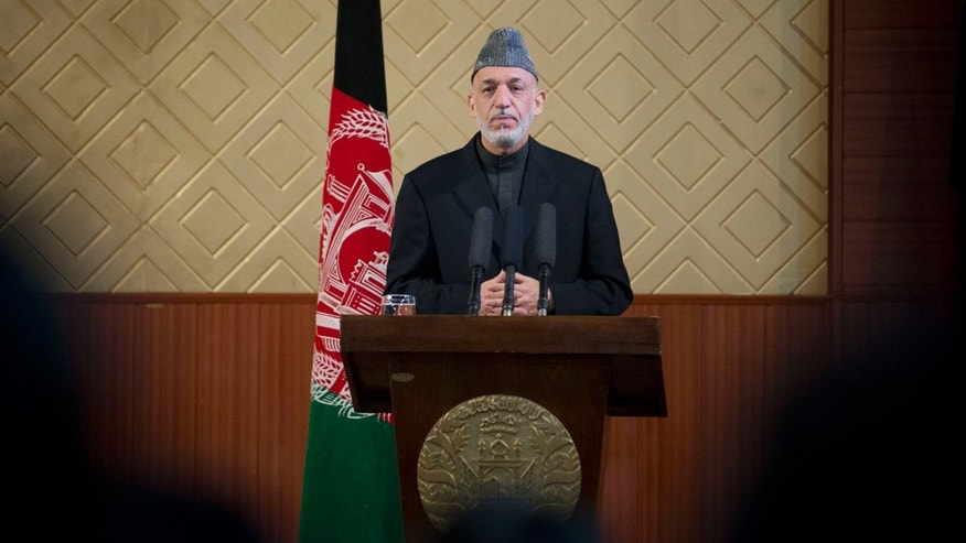 "Afghan President Hamid Karzai pauses during a ceremony at Kabul University in Kabul, Afghanistan, Thursday, May 9, 2013. Karzai said he is ready to let the U.S. have nine bases in the country after the 2014 combat troop pullout, but wants Washington's ""security and economic guarantees"" first.  (AP Photo/Anja Niedringhaus)"