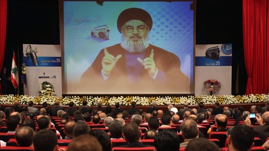 May 9, 2013: Hezbollah leader Sheik Hassan Nasrallah speaks via video during a conference, held in a southern suburb of Beirut, Lebanon.