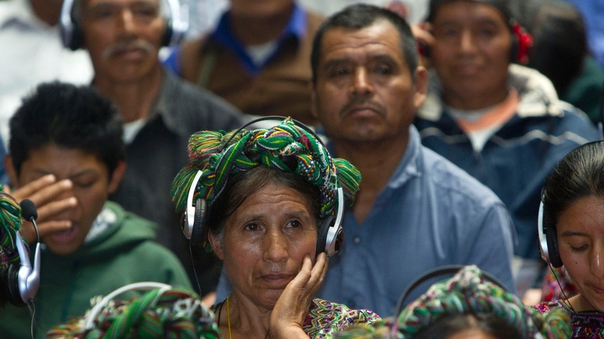 "An Ixil Indian woman, the relative of a civil war victim, uses earphones to hear translations between Spanish and the Ixil language during the genocide trial of former dictator Jose Efrain Rios Montt in Guatemala City, Thursday, May 9, 2013.  The 86-year-old ex-general says he never ordered attacks against ""a race,""denying he ordered the extermination of Ixil Mayas. Prosecutors say that while in power, Rios Montt was aware of, and thus responsible for, the slaughter of at least 1,771 Ixil Mayas in the towns of San Juan Cotzal, San Gaspar Chajul and Santa Maria Nebaj in Guatemala's western highlands. (AP Photo/Moises Castillo)"