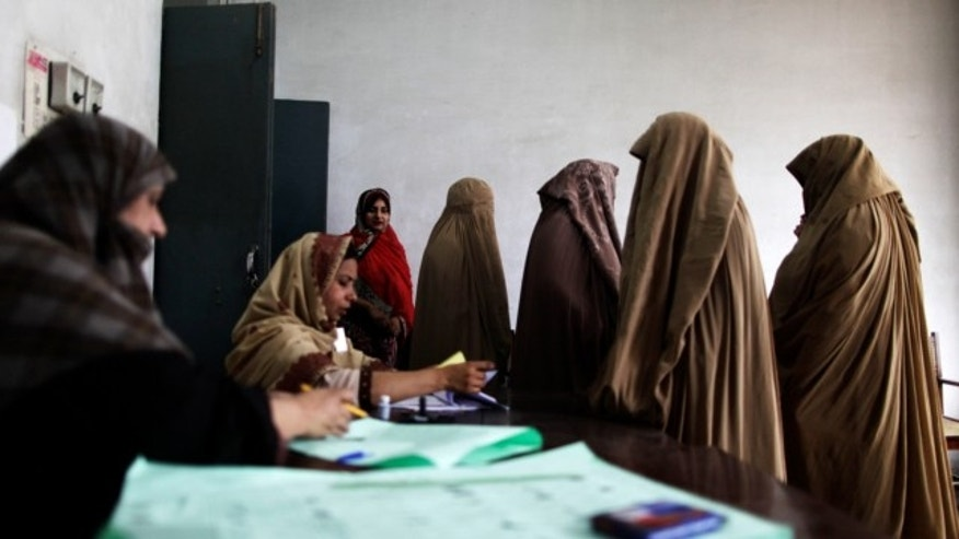 May 11, 2013: Pakistani women wait to register their names and cast their ballots at a polling station on the outskirts of Islamabad, Pakistan.