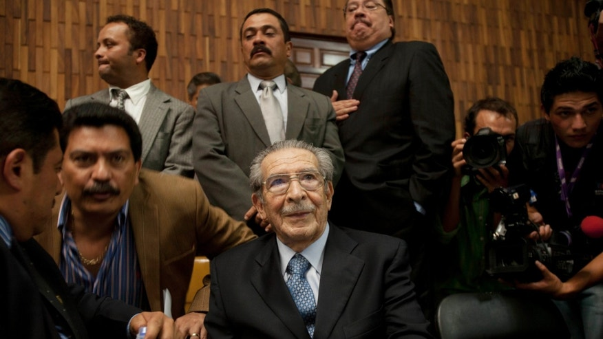 Guatemala's former dictator Jose Efrain Rios Montt sits in the courtroom before the judge enters to read the verdict in his genocide trial in Guatemala City, Friday, May 10, 2013. The Guatemalan court convicted Rios Montt on charges of genocide and crimes against humanity, sentencing him to 80 years in prison. The 86-year-old former general is the first former Latin American leader ever found guilty of such a charge. The war between the government and leftist rebels cost more than 200,000 lives and ended in peace accords in 1996. (AP Photo/Moises Castilo)