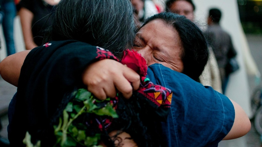 The relatives of people who were killed in the country's civil embrace after the judge's guilty verdict for Guatemala's former dictator Jose Efrain Rios Montt after his trial for genocide in Guatemala City, Friday, May 10, 2013. The Guatemalan court convicted Rios Montt on charges of genocide and crimes against humanity, sentencing him to 80 years in prison. The 86-year-old former general is the first former Latin American leader ever found guilty of such a charge. The war between the government and leftist rebels cost more than 200,000 lives and ended in peace accords in 1996. (AP Photo/Luis Soto)