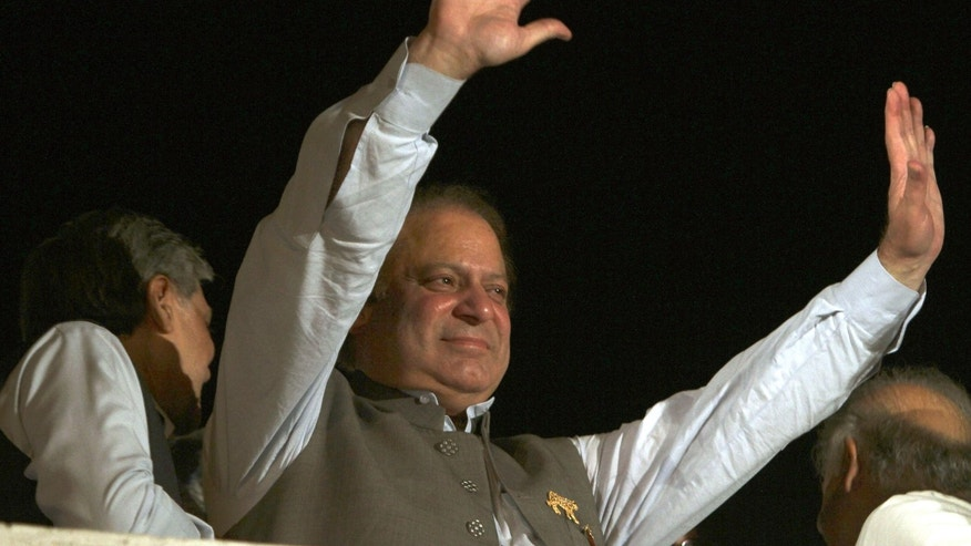 May 11, 2013: Former Prime Minister and leader of the Pakistan Muslim League-N party Nawaz Sharif waves to his supporters at a party office in Lahore, Pakistan.