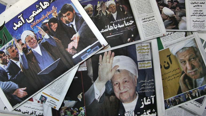 The front pages of the Sunday edition of Iranian newspapers, published with pictures of former President Akbar Hashemi Rafsanjani, a hopeful for the upcoming presidential election, are seen on Sunday, May 12, 2013. Rafsanjani's made a last minute surprise decision on Saturday to enter Iran's presidential election process, which now includes more than 680 hopefuls and will culminate June 14 with just a handful of names on the ballot to succeed Mahmoud Ahmadinejad. In one of his first statements since joining the race, Rafsanjani spoke in general terms Sunday of seeking a new ``economic and political'' rebirth in a time of ``foreign threats and sanctions.'' (AP Photo/Vahid Salemi)