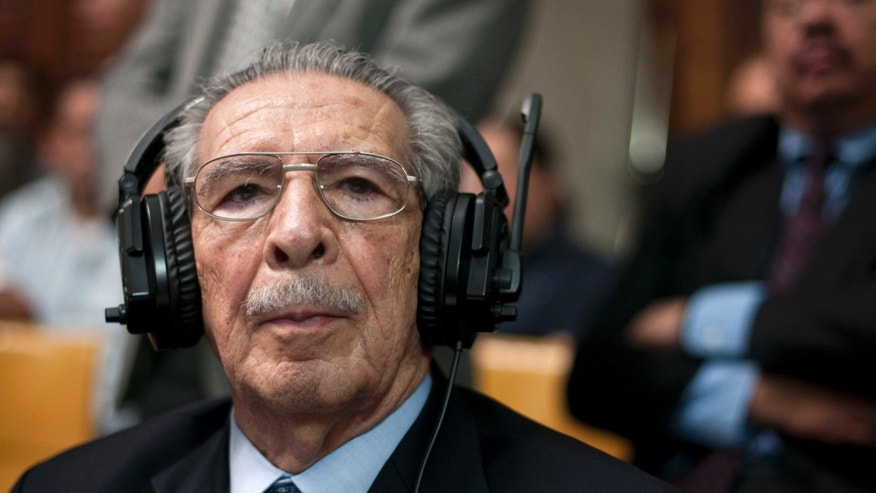 Guatemala's former dictator Jose Efrain Rios Montt wears headphones as he listens to the verdict in his genocide trial in Guatemala City, Friday, May 10, 2013. The Guatemalan court convicted Rios Montt on charges of genocide and crimes against humanity, sentencing him to 80 years in prison. The 86-year-old former general is the first former Latin American leader ever found guilty of such a charge. The war between the government and leftist rebels cost more than 200,000 lives and ended in peace accords in 1996. (AP Photo/Luis Soto)