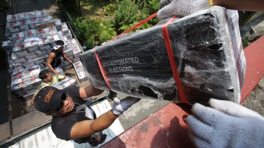 Election workers transfer official ballots on a truck at a distribution center in Manila, Philippines on Sunday May 12, 2013. The country will elect local officials from senators to congressmen and down to municipal mayors on Monday's mid-term elections. (AP Photo/Aaron Favila)