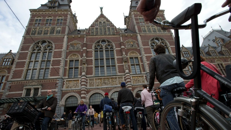May 13, 2013 - Hundreds of bicycles pass through Rijksmuseum, in Amsterdam, Netherlands.