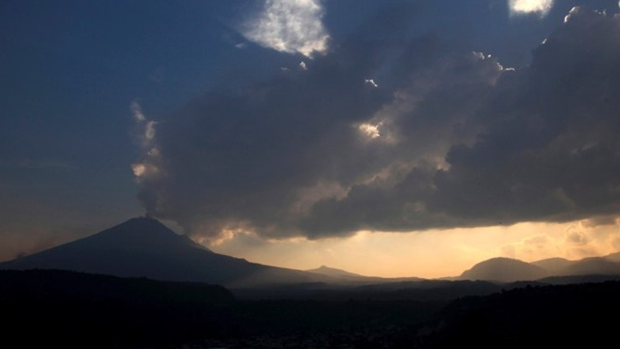 May 12, 2013: The Popocatepetl volcano spews ash and steam as seen from Santiago Xalitzintla, Mexico.