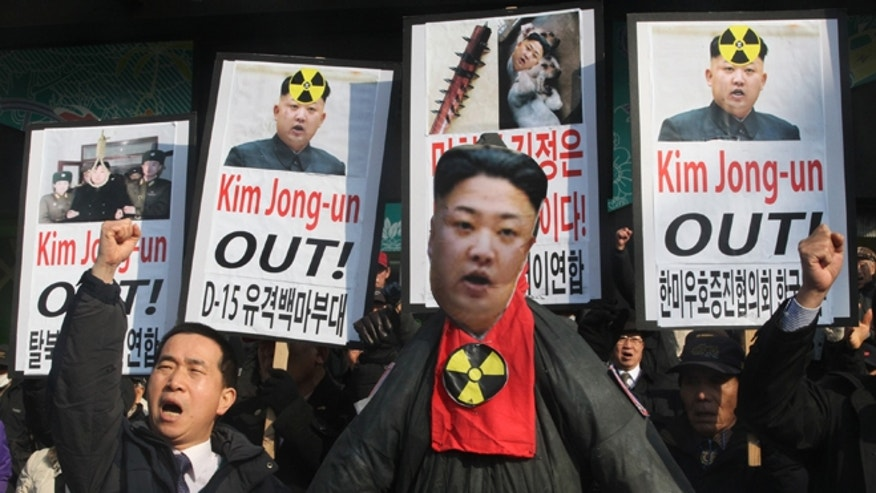 Feb. 13, 2013: A South Korean protester shouts slogans near an effigy of North Korean leader Kim Jong Un during an anti-North Korea rally to denounce North Korea's nuclear test in Seoul, South Korea, a day after North Korea defied U.N. warnings with a nuclear test.