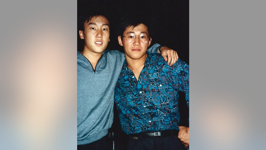 1988 FILE photo provided by Bobby Lee shows Kenneth Bae, right, and Bobby Lee together when they were freshmen students at the University of Oregon. North Korea says Kenneth Bae, who was sentenced  to 15 years hard labor, smuggled in unspecified inflammatory literature and tried to establish a base for anti-Pyongyang activities at a hotel in the border city of Rason.