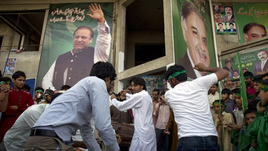 Supporters of Pakistan's former Prime Minister Nawaz Sharif celebrate the victory of their leader in Islamabad, Pakistan on Sunday, May 12, 2013. Sharif looked set Sunday to return to power for a third term, with an overwhelming election tally that just weeks ago seemed out of reach for a man who had been ousted by a coup and was exiled abroad before clawing his way back as an opposition leader. (AP Photo/B.K. Bangash)