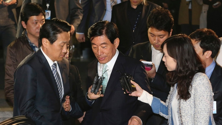 "In this photo taken on Tuesday, April 30, 2013, former National Intelligence Service director Won Sei-hoon, center, leaves Supreme Prosecutors' Office after being summoned, in Seoul, South Korea. The scandal shaking up South Korea's main spy agency is not cloak-and-dagger stuff, but the kind of low-grade trickery anyone with an Internet connection could pull off. And the target was not Seoul's opaque rival to the north, but the country's own people. Internet postings ostensibly from ordinary South Koreas, but actually from National Intelligence Service agents, allegedly boosted President Park Geun-hye while she was running for the job as the ruling party's nominee. She was reportedly dubbed ""the best,"" while her opponent, in a play on his name, was called ""criminal."" (AP Photo/Yonhap, Im Hun-jung) KOREA OUT"