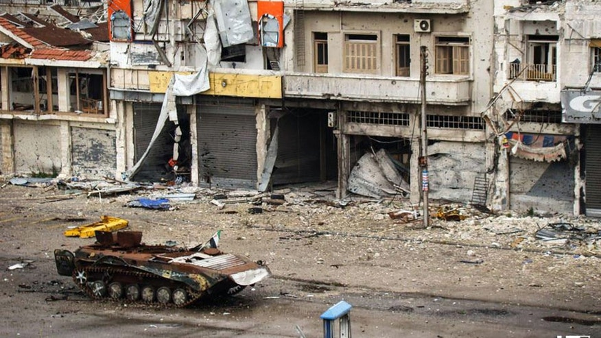 May 13, 2013. - This citizen journalism image provided by Lens Young Homsi, shows a destroyed Syrian tank at al-Qossur neighborhood in Homs province, Syria.