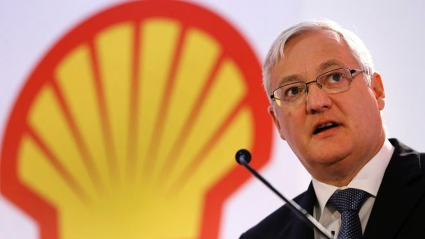 May 14, 2013: In this file photo from Jan. 31, 2013 Peter Voser, Chief Executive Officer of Shell, speaks at the Royal Dutch Shell's full year results 2012 press conference, in London. European anti-trust authorities have launched investigations into at least three oil companies, including Royal Dutch Shell, on suspicion of price-fixing.