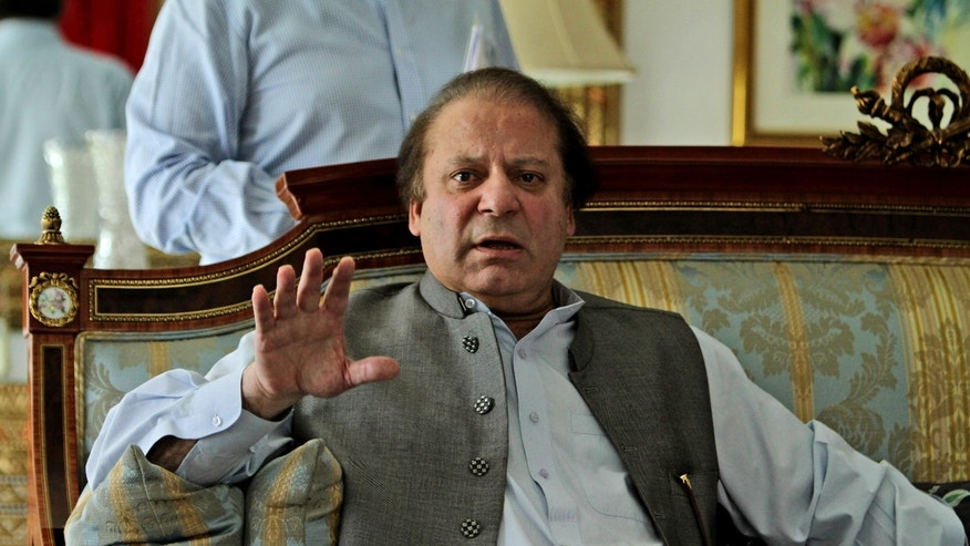 "Former prime minister and leader of Pakistan Muslim League-N party, Nawaz Sharif, gestures while speaking to members of the media at his residence in Lahore, Pakistan, Monday, May 13, 2013. The Pakistani politician poised to become the country's next prime minister said Monday that Islamabad has ""good relations"" with the United States, but called the CIA's drone campaign in the country's tribal region a challenge to national sovereignty. (AP Photo/K.M. Chaudary)"