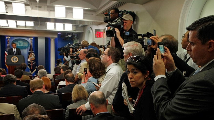 WASHINGTON - JUNE 23:  Reporters squeeze in the aisle while using hand-held digital devices to make images of U.S. President Barack Obama during a news conference in the James S. Brady Briefing Room at the White House June 23, 2009 in Washington, DC. Obama was expected to discuss the high cost of health care, energy independence and the post-election disputes in Iran.  (Photo by Chip Somodevilla/Getty Images)