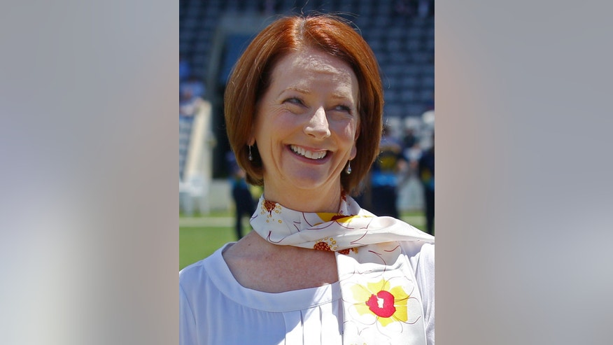 FILE - In this Tuesday, Jan. 29, 2013 file photo, Australian Prime Minister Julia Gillard smiles as she attends a cricket match in Canberra, Australia. In a rare departure from her characteristically tough style, a teary-eyed Gillard introduced a new tax bill to Parliament on Wednesday, May 15, 2013, that would fund better care for Australians with severe physical and mental disabilities. (AP Photo/Rick Rycroft, File)