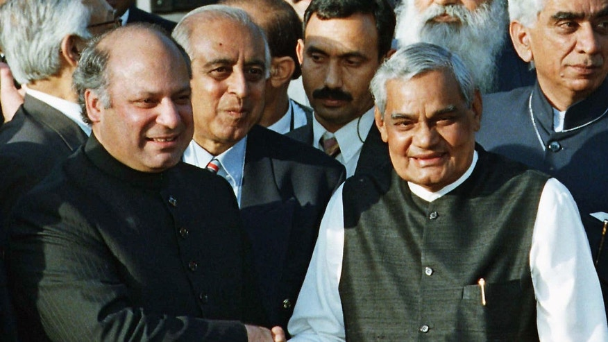 "FILE - In this Saturday, Feb. 20, 1999 file photo, Pakistani Prime Minister Nawaz Sharif, left, receives Indian Prime Minister Atal Bihari Vajpayee at the Wagah border near Lahore, Pakistan.  Over a decade ago, the man now set to become Pakistan's next prime minister stood at this border crossing with archenemy India to inaugurate a ""friendship"" bus service connecting the two countries. There is widespread hope on both sides of the border that Nawaz Sharif will take similarly bold steps to improve relations with India following his election victory in May 2013, thus reducing the chance of a fourth major war between the nuclear-armed foes. (AP Photo/B.K. Bangash, File)"