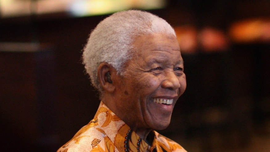 CAPE TOWN, SOUTH AFRICA - APRIL 03:  Nelson Mandela smiles during a lunch to Benefit the Mandela Children's Foundation as part of the celebrations of the opening of the new One&Only Cape Town resort on April 3, 2009 in Cape Town, South Africa. The One&Only is Sol Kerzner's first hotel in his home country since 1992. The 130 room property is One&Only's first Urban resort and sits in the fashionable Waterfront district. Celebrities from all over the world including Mariah Carey, Clint Eastwood, Matt Damon, Morgan Freeman,  Thandie Newton, Marisa Tomei will attend the event. Gordon Ramsay will be launching his first restaurant in Africa at the resort, Maze and Robert De Niro will be opening Nobu. Nelson Mandela will be attending an intimate luncheon at Maze on Friday to celebrate his long-standing relationship with Mr. Kerzner.  (Photo by Chris Jackson/Getty Images)