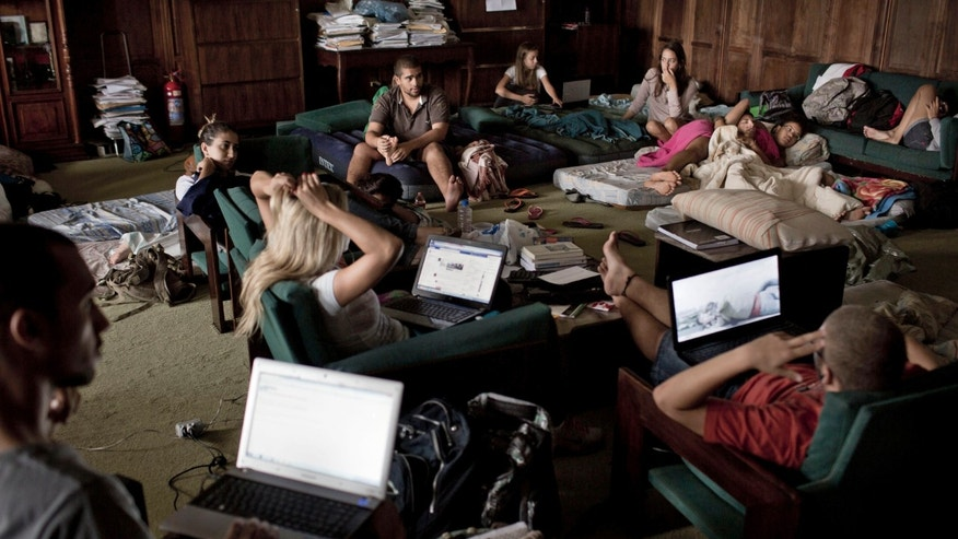 In this March 27, 2013 photo, students occupy the administrative offices of the Rio de Janeiro Rural Federal University, UFRRJ, to protest the school's conditions in Seropedica, Brazil. Laboratories routinely flood when it rains, lecture halls reach oven-like temperatures because the burned-out AC units were never replaced, the Internet works only intermittently and students hardly dare venture out after dark for fear of being mugged. (AP Photo/Felipe Dana)